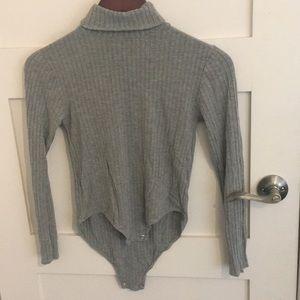 Grey, longsleeve bodysuit.